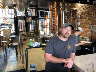 Photo of Craig Moore. Doin' Good in the 'Hood: Craig Moore, Old Fourth Distillery. Taken by Tony Paris.